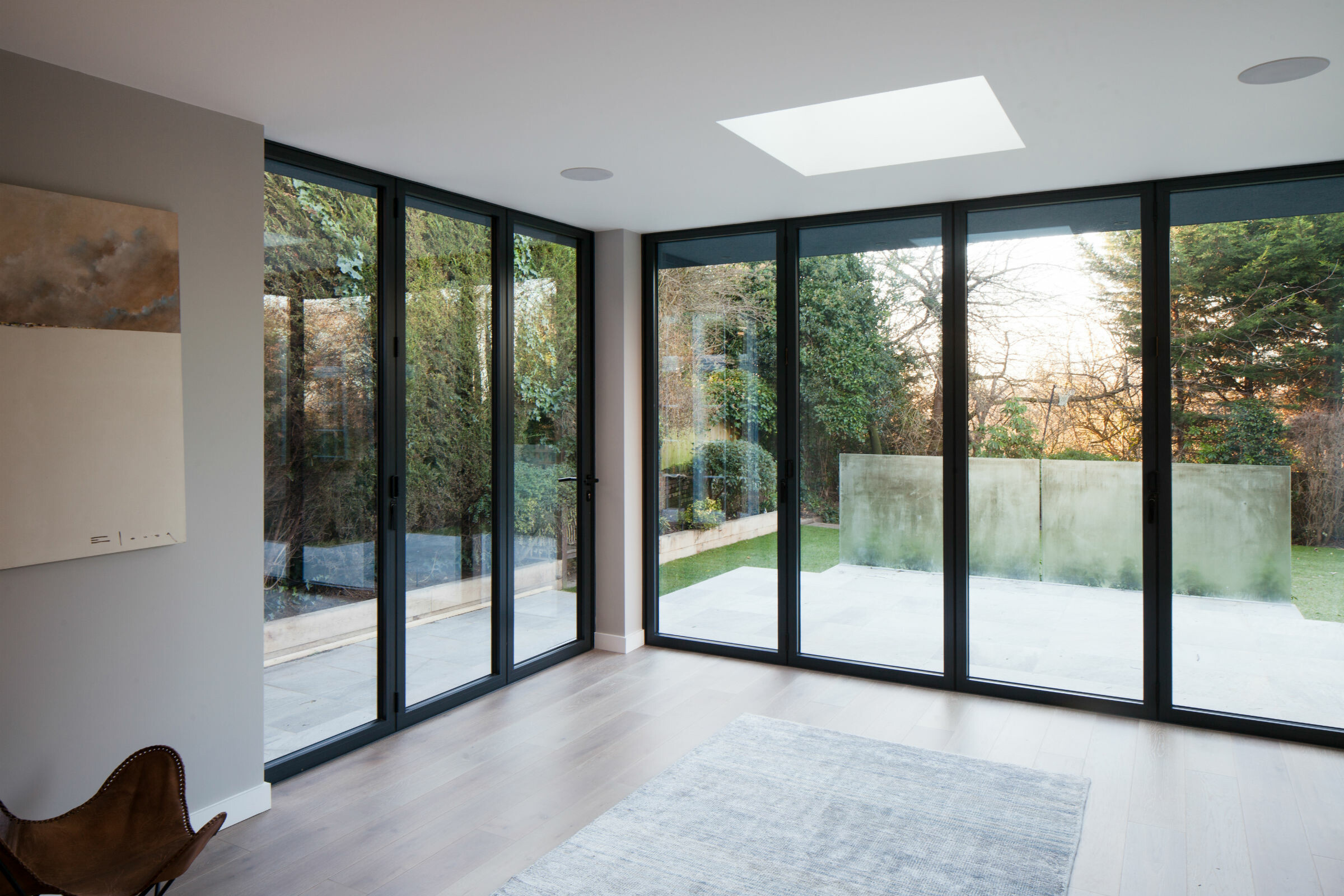 Modern room with full height doors leading to garden