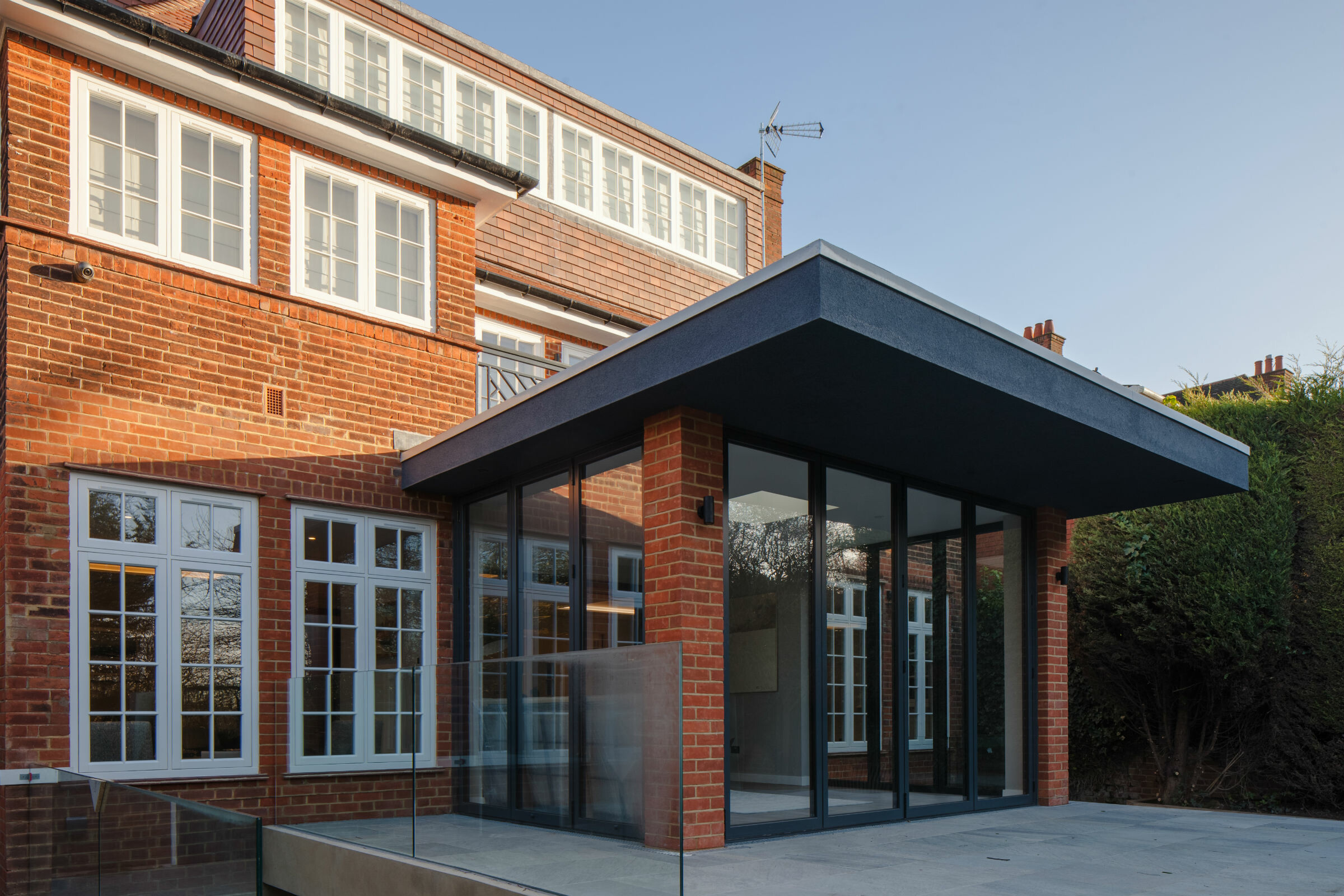 Modern house extension with flat roof