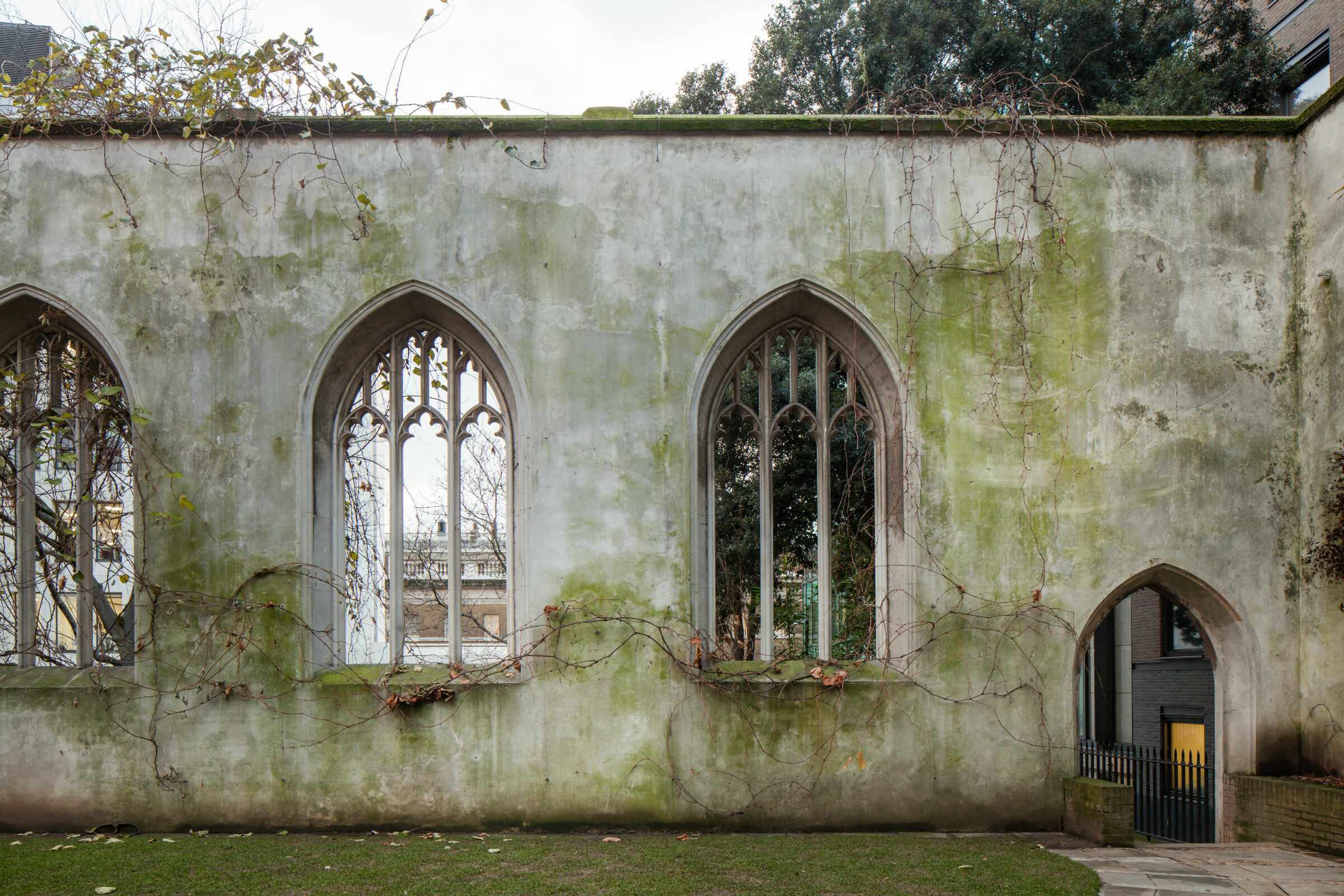 Moss covered masonry walls of St Dunstan's church