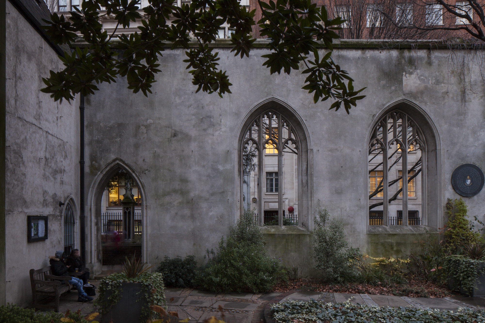 Masonry walls and planted gardens of  St Dunstan's church